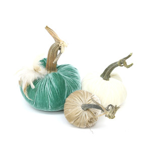 """The New LoveFeast Pumpkin Trio with Feathers includes a 6"""" Lagoon velvet pumpkin with feather plume, 5"""" Ivory velvet pumpkin and 4"""" Bone velvet pumpkin."""