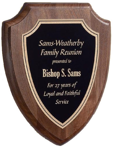 A large solid walnut shield plaque made by Victory