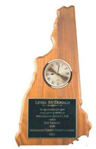 A solid walnut plaque in the shape of New Hampshire with a decorative clock
