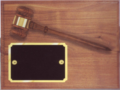A solid walnut plaque with a removable gavel