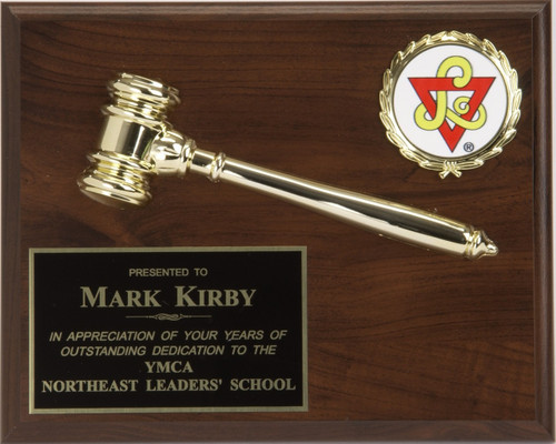 A laminate plaque with an attached decorative gold gavel with seal or logo