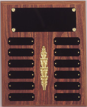 "A 10.5"" x 13"" walnut finish perpetual plaque with 12 plates and a decoration"