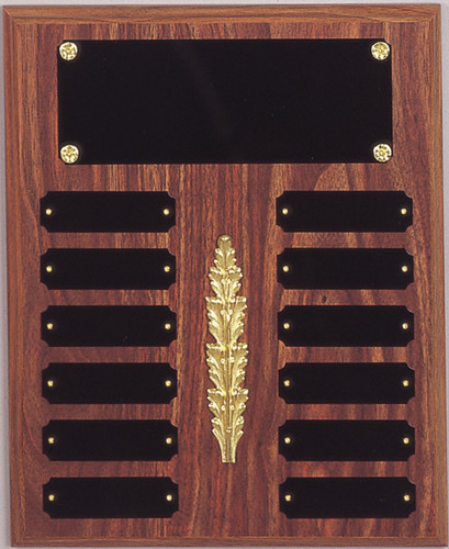 """A 10.5"""" x 13"""" walnut finish perpetual plaque with 12 plates and a decoration"""