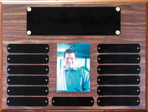 "A 10.5"" x 13"" walnut finish perpetual plaque with 13 plates and a picture holder"