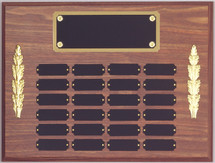 "A 12"" x 16"" walnut finish perpetual plaque with 24 plates and side decorations and a brass backer plate"