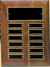 "A 9"" x 12"" solid walnut perpetual plaque with 12 plates manufactured by Victory"