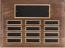 "A 9"" x 12"" horizontal solid walnut perpetual plaque with 12 plates manufactured by Victory"