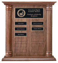 "A 12"" x 13"" solid walnut perpetual plaque with 12 plates manufactured by Victory"