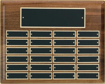 "A 9"" x 12"" horizontal high gloss piano finish walnut perpetual plaque with 12 plates manufactured by Victory"