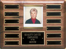 "A 9"" x 12"" solid walnut perpetual plaque with 12 plates and picture holder manufactured by Victory"