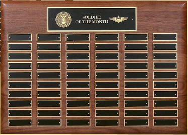 "A 15"" x 21"" solid walnut perpetual plaque with 60 plates manufactured by Victory"