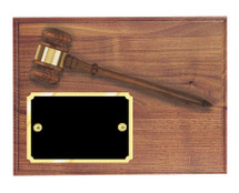 A solid walnut plaque with attached gavel