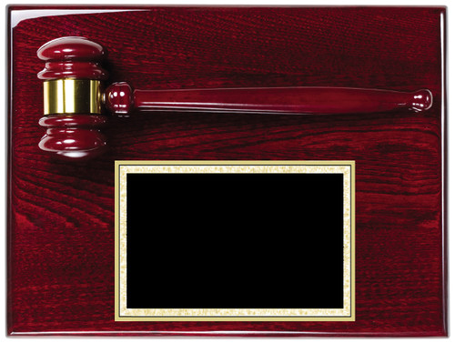 A rosewood piano finish plaque with gavel