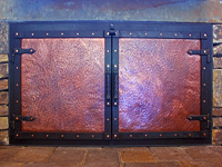 hand forged copper panel fireplace doors
