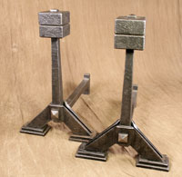 Hand forged fireplace andirons by blacksmiths at Ponderosa Forge