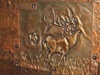 copper elk repousse in copper patchwork door