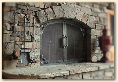 hand forged fireplace doors custom built by blacksmiths at Ponderosa Forge in Sisters, Oregon
