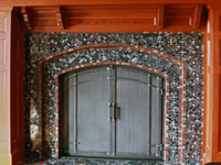 hand forged fireplace doors with craftsman grid and marble surround