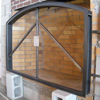 New contructions mason frame for easy installation of custom hand forged fireplace doors by Ponderosa Forge