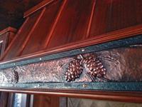 pine cone reppousse range hood strap