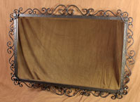 wrought iron scrolled mirror