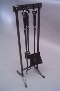 Hand forged fireplace tools by blacksmiths at Ponderosa Forge