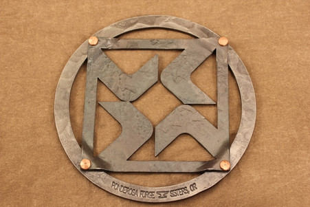 iron trivet with black butte ranch logo