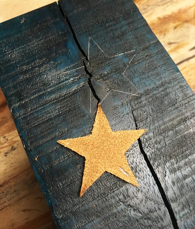 Trace the decorative leather stars onto your wood candle holders