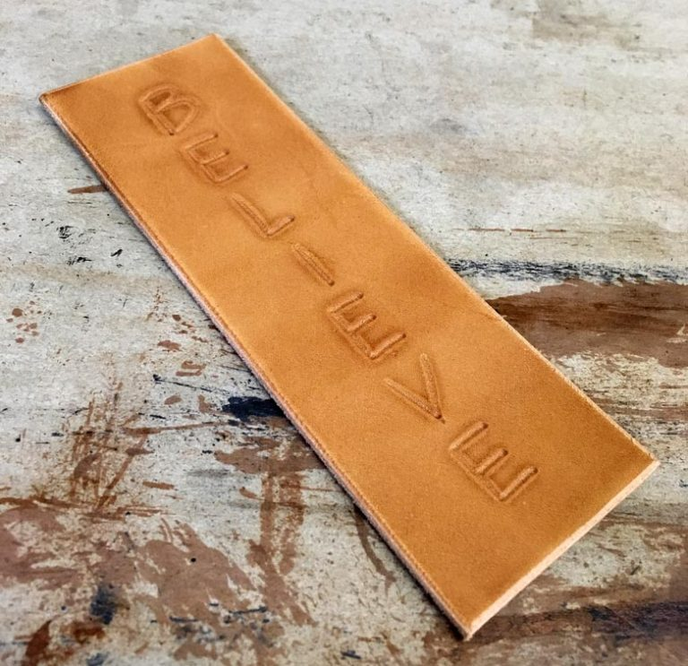 Use neatsfoot oil to darken your decorative leather panel