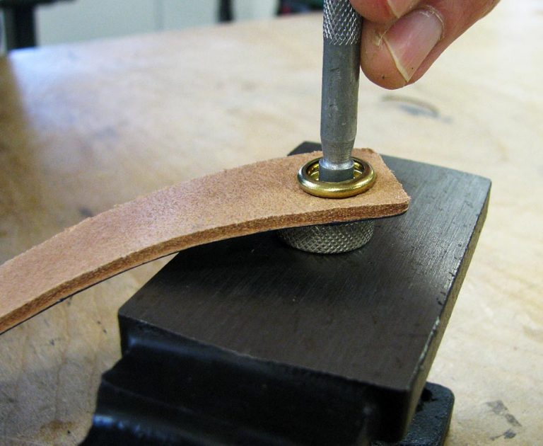 Set the socket and cap snap against a concave anvil