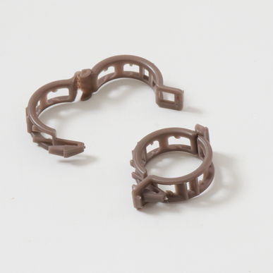 Our current stock of clips are brown and larger that the older white ones.