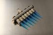 Prebuilt Customizable Linear Spinneret Array Kit (p/n 100-10-PCLSAK) shown with optional disposable tips.