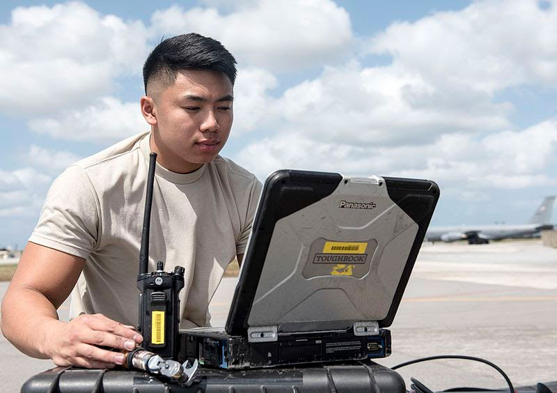 aviation technician working with a toughbook in the field
