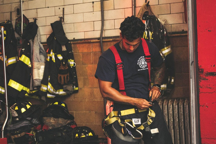 firefighter gearing up for incident response