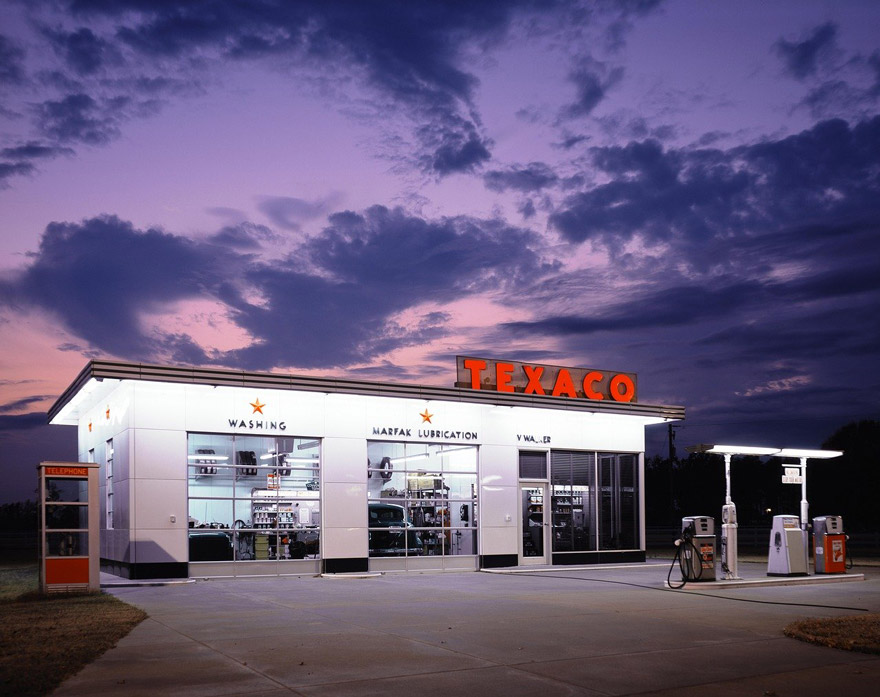 Exterior image of an auto repair shop at sundown