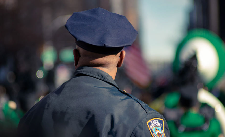Uniformed police officer from behind