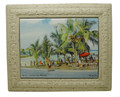 A framed tile with a painting of Little Bay, St. Lawrence Gap in Barbados by Jill Walker