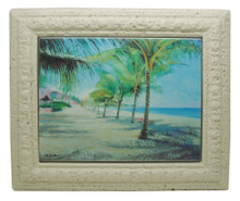 A framed tile with a painting of Dover Beach in Barbados by Jill Walker