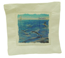 A linen cocktail napkin with a print of flying fish by Holly Trew
