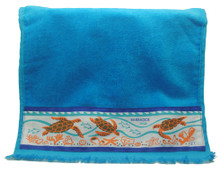 A guest towel with hand screen printed turtles.