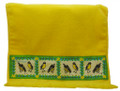 A guest towel with screen printed bananaquits in Barbados.