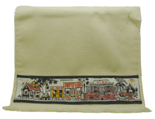 A guest towel with hand screen printed Barbadian chattel houses.