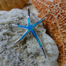 Starfish pendant made of stirling silver and blue opal.
