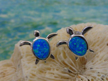 Turtle stud earrings made of sterling silver and blue opal.