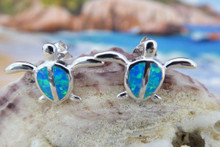 Turtle earrings made of sterling silver and blue opal.