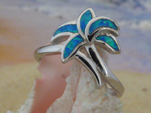 Palm ring made of sterling silver and blue opal.