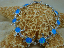 Turtle bracelet made of sterling silver and blue opal.