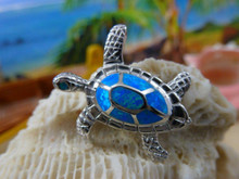 Turtle pendant made of sterling silver and blue opal.