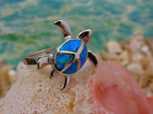 Turtle ring made of sterling silver and blue opal.