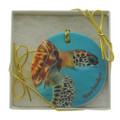 A beautifully boxed, flat ceramic ornament with a painting of a green turtle by Sue Trew.